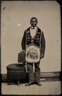 A man in his Freemason's apron.