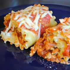 Lasagna Roll Ups -   8 lasagna noodles  1/2 pound lean ground turkey  1 T olive oil  1 clove garlic  1/2 onion  1 can crushed tomatoes  1 egg  1/2 cup ricotta cheese  1/4 cup grated Parmesan cheese  1 1/2 T fresh basil, chopped  1 1/2 T fresh oregano, chopped  1/4 cup shredded mozzarella cheese  1/2 tsp crushed red pepper flakes