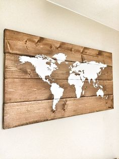 This Rustic Wooden World Map is a unique piece for your home or office! White hand painted map is sealed onto a rustic wood base. The wood has been sanded smooth, stained in a walnut brown, painted & distressed by hand for that perfect rustic touch Measures: 26 inches by 14 inches