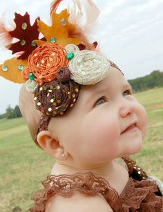 Fall Flower and Feather Headband-Thanksgiving Baby Girls Vintage Headband-Rolled Flower Headband-Headband with Feathers. $14.95, via Etsy.
