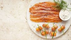 This recipe for salmon gravadlax pinwheels with cream cheese from Andrew Rudd, executive chef and owner at Medley, is perfect for entertaining. Christmas Canapes, Christmas Recipes, Cheese Food, Cheese Recipes, Curing Salt, Plastic Containers With Lids, Salmon Fillets, Executive Chef, Beetroot