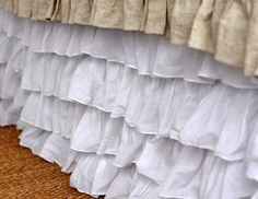 Bed skirt.  I could make this with 3 or 4 plain bed skirts EASY!