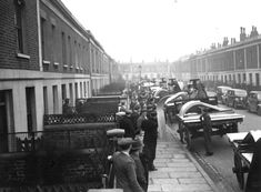 25 Feb 1939: Anderson air raid shelters are delivered to homes in Tiber Street, Islington