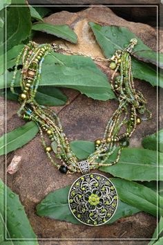 Verdant green and earthy hues as varied as the earth  $30.00, via Etsy.  SOLD  Copyright Paradigma Jewelry 2012