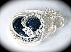 Wire wrapped blue sandstone pendant