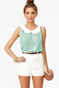 Peter Pan Collar top. Also love the shorts and the casual high bun hairstyle