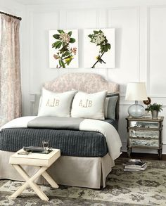We love choosing square or rectangular art pieces to go over a curved headboard. It brings the perfect amount of balance to a bedroom.