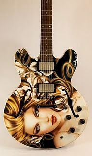 airbrush custom guitar, would love to have one with my wife pam on it...