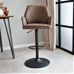 Industrial bar stool Donny immediately catches the eye due to its special design. The combination of stitching and design gives the bar stool a tough appearance. In addition, the bar stool 360 degrees rotating and height adjustable. Taupe, Chair, Steel Frame, Bar Stools, Pu Leather, Furniture, Industrial, Metal, Interior