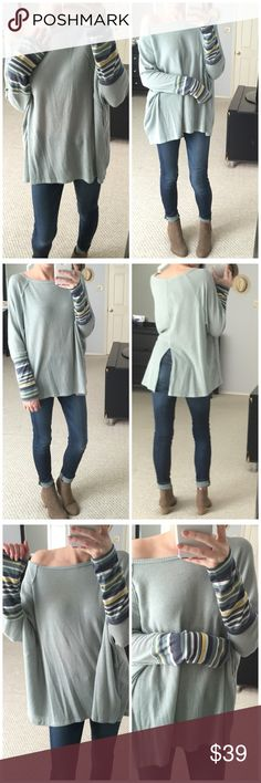"""▫️Sage Waffle Knit Dolman w/ Striped Cuffs Sage waffle knit dolman top with adorable striped cuffs on the arms. Slit up back makes for a cute little extra! Stretchy and has an oversized fit. Rounded neckline and raw hem throughout. Just so cute! Modeling small. Also available in Ivory. 49% polyester 49% rayon 2% spandex. Measurements as follows: Length: (S) 25/27"""" (M) 26/28"""" (L) 27/29"""" *Bundle 2+ items for a discount. Tops Tees - Long Sleeve"""
