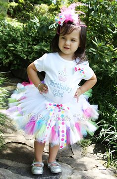 Whimsical Cupcake Girly Birthday Girls Tutu Set       Birthday Girls just want to have fun! Any little girl will love wearing our Birthday Girl Cupcake themed tutu set! Comes with colorful bling top with cupcake and Birthday Girl saying.       Show her off in our matching bright petutti tutu skirt with big polka dots bow and fun colored tulle. Big bright dots hair bow is topped with hot pink marabou. A fun and unique Birthday outfit for your special princess.