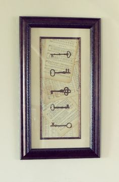 use old book pages and vintage keys on old barn boards    Could do a map in the background with cool objects over it?