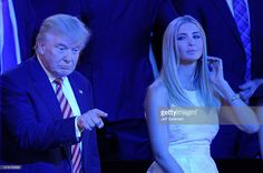 Republican presidential candidate Donald Trump gestures as Ivanka Trump looks on during the third day of the Republican National Convention on July 20, 2016 at the Quicken Loans Arena in Cleveland, Ohio. Republican presidential candidate Donald Trump received the number of votes needed to secure the party's nomination. An estimated 50,000 people are expected in Cleveland, including hundreds of protesters and members of the media. The four-day Republican National Convention kicked off on…