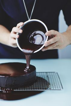 Mirror Glaze Recipe. Heat the sugar, water and golden syrup in a small saucepan. Allow to boil for a minute or two, then remove from the heat and whisk in the cocoa powder. Whisk in the cream, then return to a medium heat for a minute, stirring constantly. Remove from the heat. Add softened gelatin and stir until dissolved.