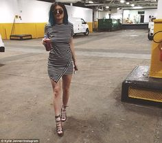 Kendall Jenner dons low-cut black number while promoting new book #dailymail