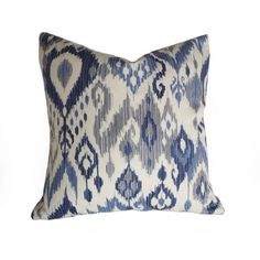 Blue and white (slight cream) ikat pillows remind me of a coastal beach house with white linen curtains and slip covered sofas... Casual but still elegant. The…