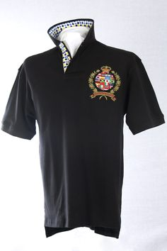 Our classic-fitting short-sleeved polo in breathable cotton interlock, finished with captivating Robert Owen Collection signature patch and embroidery.  Color: Black  Collar: (Black, Yellow, Navy Dots)   Two-button concealed twill placket,contrasting twill collar. Collar topside has fashionable print similarities of placket. Our embroidered International Crest accents the left chest. Accompanied by matching handkerchief. 100% cotton. Machine washable. Imported.  $70.00