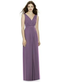 Full length sleeveless lux chiffon dress w/ draped bodice and v-neckline. Pleated detail at front and back skirt. Shown in Smashing.