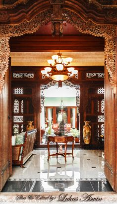 Javanese carved door-frame and partition (gebyok)