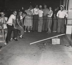 People gathered on a sidewalk in Phenix City, Alabama, the night Albert Patterson was assassinated. :: Alabama Photographs and Pictures Collection