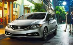 2015 Honda Sedan Exterior   Great shot of the 2015 Civic   Sweet in Silver   Read the review to learn more