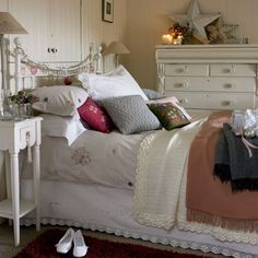 Choose vintage-style bedlinen    Layer up a comfortable bed with pretty embroidered vintage-style bedlinen and cushions, then pile on crochet blankets for added warmth. Crochet-edged pillowcases and sheets create a classic country look.