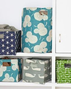 These poly-lined canvas bins come in such cute patterns! Printed Canvas Storage Bins, Garnet Hill
