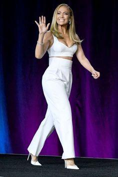 Jennifer Lopez brought a bedazzled Judith Leiber football clutch to a pre-Super Bowl press event in Miami. Vestido Jennifer Lopez, Jennifer Lopez Ropa, Jennifer Lopez Outfits, Jennifer Looez, Club Dresses, Nice Dresses, Dressy Dresses, Elegant Dresses, Party Dresses