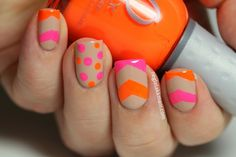 I think this is so cute, want to try it in a neon yellow & pink!  This mani is on polishchest.blogspot.com