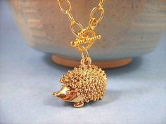 Gold Hedgehog Necklace The Hedgehog Who Fell in by justCHARMING, $14.00 https://www.etsy.com/listing/34503712/gold-hedgehog-necklace-the-hedgehog-who