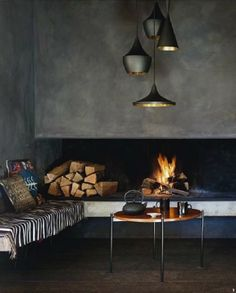 Concrete fireplace with Tom Dixon's lamps