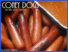 Coney Dogs in the Slow Cooker.  Cook your coney sauce or chili right alongside your hot dogs or sausages in the slow cooker in just a few hours!  Perfect for a Super Bowl party!
