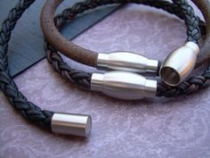 A simple and tasteful leather bracelet. This bracelet style features Fine Imported Quality - 4mm thick leather cord and a secure stainless steel magnetic closure clasp ( 20 mm or approx 3/4 inch in length) for easy on and off. Take your pick from these three available colors. All dyes used in our leather are certified 100% Lead-Free and meet all requirements of the German Goods Ordinance, REACH (European Union), RoSH (U.K.), and CPSIA (U.S.) which require consumer goods to be free of Lea...