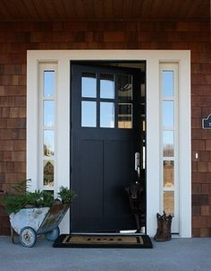 I like the layout, solid front door with windows either side... Maybe stained glass.