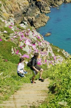 Cliff walkers at Creux Mahie, Torteval in Guernsey.