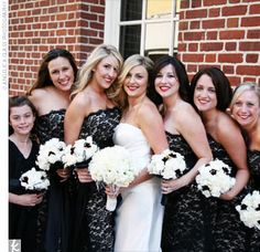 Each of Jen's five bridesmaids donned a strapless, black lace dress with a black sash at the waist from the Dessy Collection.