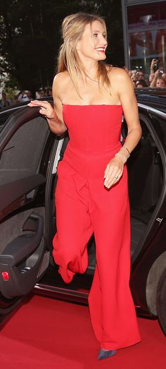 Cameron Diaz opts for a red floor-length strapless jumpsuit. // #Celebrity