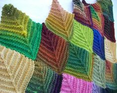 Knitted mitered squares, alternating knit and perl looks like leaves. Use up the left-overs of sock yarn.