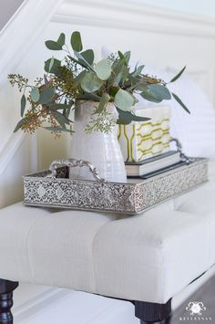 Decked and Styled Spring Home Tour - Kelley Nan- foyer with bench and eucalyptus
