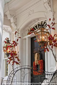 Cool Ideas of the Fall Front Door Decorations : Fascinating Black Fall Front Door With Red Garland And Red Leaves Designs