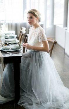 Раздельное свадебное платье. Верх - белый гипюровый топ с коротким рукавом, под ним белый шелковый топ на бретелях. Низ - светло-голубая юбка пачка из мягкого фатина в пол со шлейфом на шелковой подкладке.Шьем это платье по фотографии.
