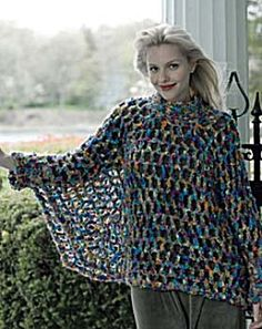 Poncho with Pizzazz- This versatile sweater/poncho has a flattering fit that is right for almost everyone. The loose, easy double crochet and chain mesh stitch makes it a quick project. It is worked in rounds from the neck down in one piece.