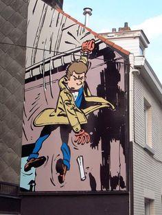 """Maurice Tillieux - Gil Jourdan - C'est dans la commune d'Auderghem ou Maurice Tillieux a séjourné plus de 25 ans qu'il a créé le personnage du détective Gil Jourdan. Cette fresque est tirée d'une case de """"La voiture immergée"""" - de 2001. (Fresque n°--) Inauguration 7 Octobre 2006. (Fresque réalisée à l'occasion du 50e annivesaire de la création du personnage de Gil Jourdan) Rue du Vieux Moulin 56 (Auderghem)"""