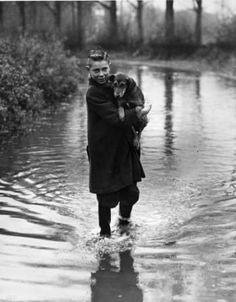 65 Photos Spanning Two Centuries Of Flooding In Britain Car Parts And Accessories, Flooded Roads, Me And My Dog, Black And White Photography, Got Him, Old Pictures, Vintage Photos, Pet Dogs, Britain