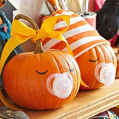 Halloween Binky Babies ~ For these sweet, sleepy babes, start with small round pumpkins. For each, cut the nipple from a pacifier and attach the base to the pumpkin with pins, pressing them through any holes in the pacifier. Add eyes with black marker. Top with a baby's cap or, if there's a long curly stem, tie on a ribbon bow. Also cute for an October baby shower :)