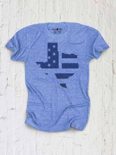 God Bless Texas. And God Bless America. ...Details... .Tri-Blend (50% Polyester / 25% Combed and Ring-spun Cotton / 25% Rayon) .Slim, comfortable fit . Made