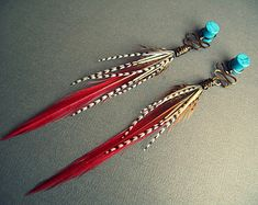 Feather dangle plugs: organic gauged earrings in stone, wood, bone, or horn, wire wrapped with top quality feathers. These striking primal plugs are