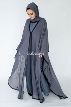 As flattering as it is stylish. Delicately scattered with black pearls and exposed with a lace hem this abaya will lend a sophisticated touch to any event. Made in the UAE. Niqab Fashion, Muslim Fashion, Fashion Dresses, Hijab Dress, Dress Hats, Black Abaya, Arabic Dress, Head Scarf Styles, Black Pearls
