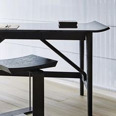 Smooth shapes, polished finishes, a serene balance of forms. The Nagoya desk. (Stool by Pierre Chareau).
