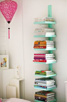 bookshelf idea, thinking of using idea as a base idea for a wall of shelves; vertical piece on studs (every other one), horizontal space further apart and staggered to allow room for larger pics, frames and such